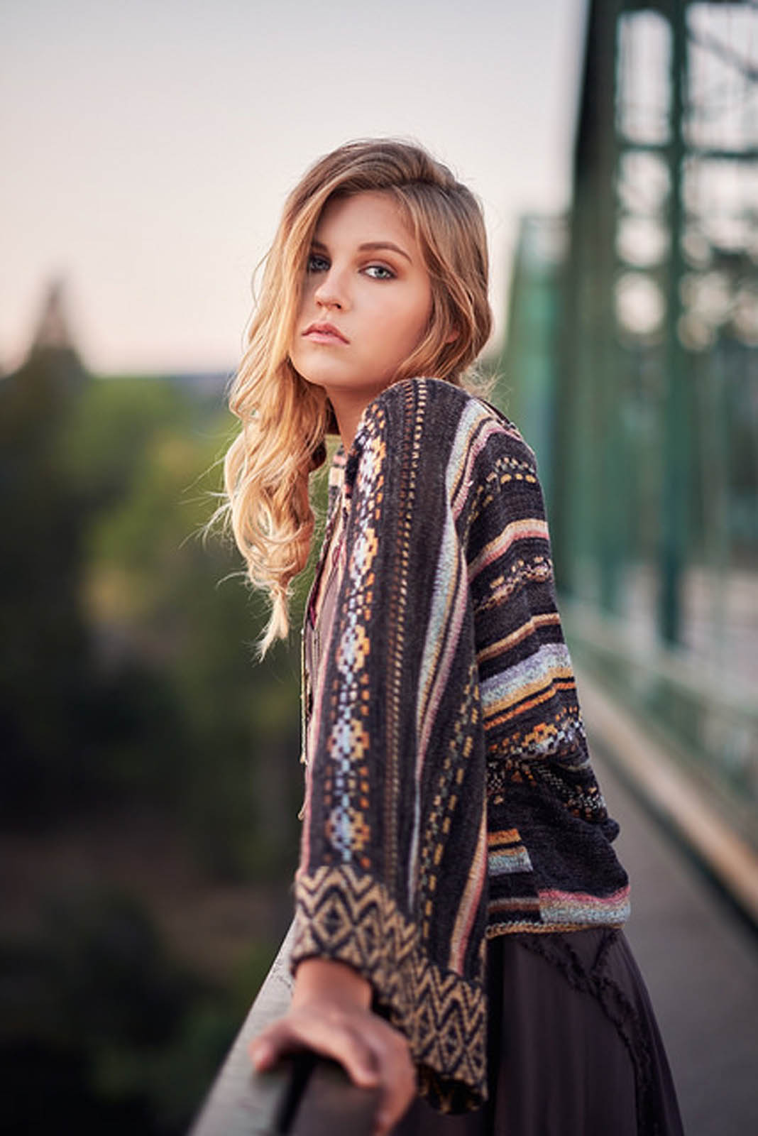 Young woman wearing Free People sweater.