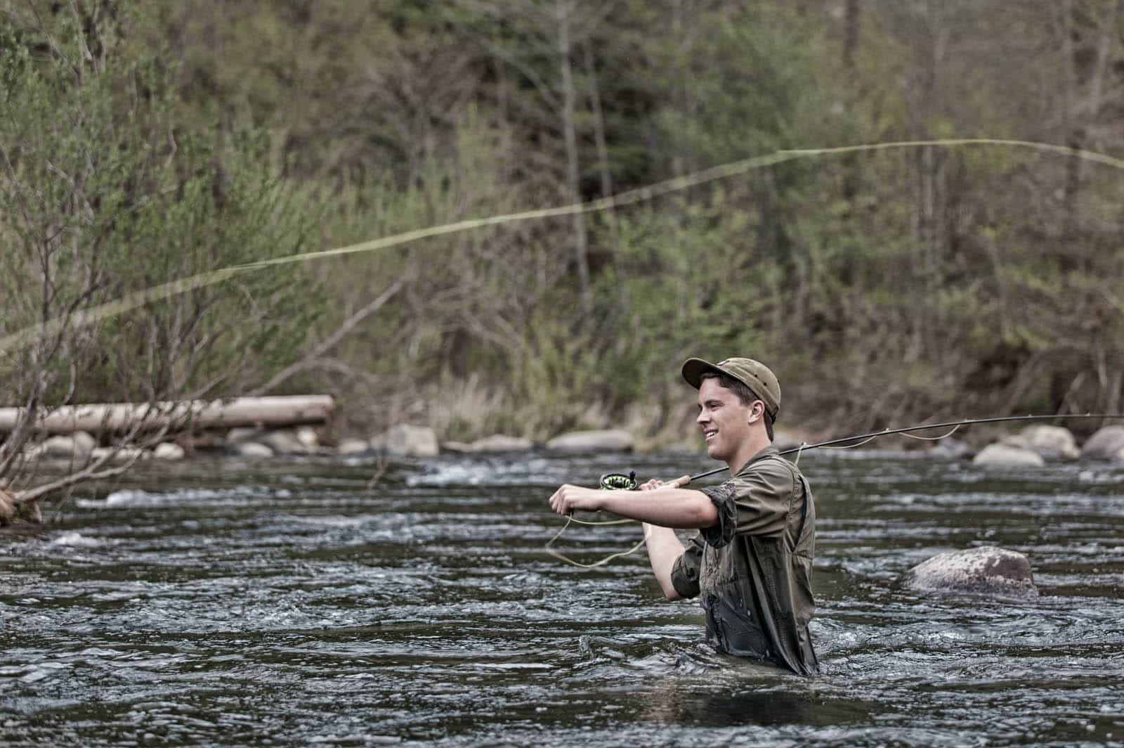 A fly fisherman fishing on the Feather River in Northern California.
