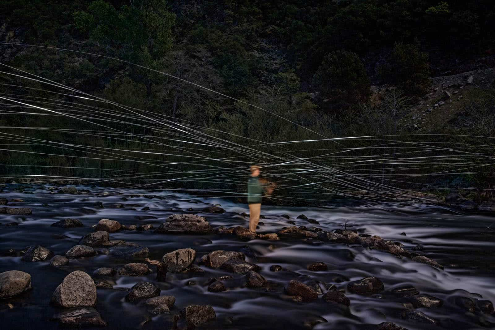 long exposure of a fly fisherman at night