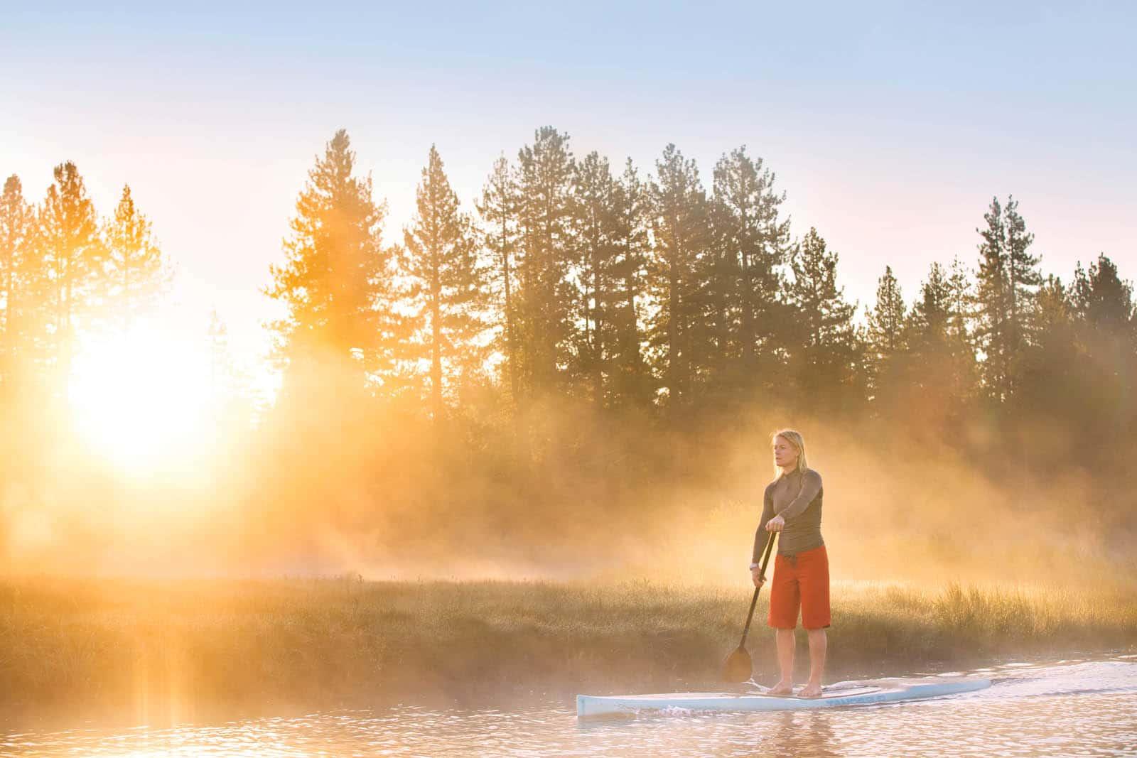 Lel Tone enjoying an early morning paddle on Lake Tahoe.