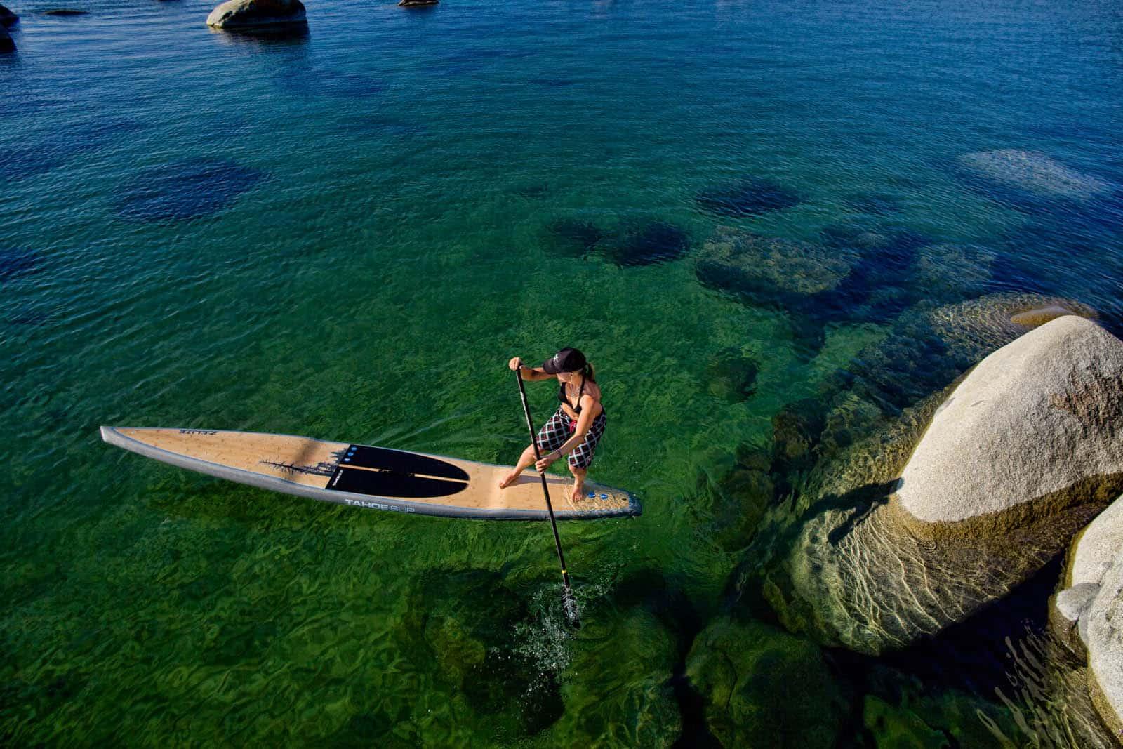 Lel Tone turning on a paddleboard